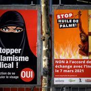 La Suisse adopte l'initiative anti- burqa d'une courte majorité