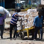 Près de 20 millions de cas en Inde, où l'aide internationale arrive