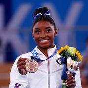 JO: Simone Biles retrouve le sourire et se console avec du bronze