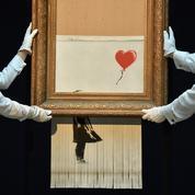 La Fille au Ballon ,œuvre autodétruite de Banksy, s'envole à 21,8 millions d'euros.