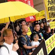 Un tribunal de Hongkong condamne trois figures de la «révolte des parapluies»