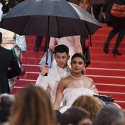 Cannes sous l'objectif: jour 6, rien n'arrête les stars, pas même la pluie
