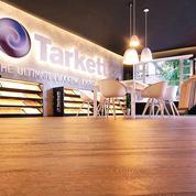Tarkett fait des économies pour redresser la barre