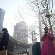 Coronavirus: la Chine accroît la surveillance de la population