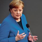 Allemagne: Angela Merkel joue la fibre européenne pour surmonter les divisions
