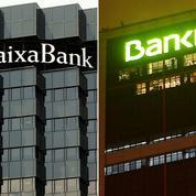 CaixaBank et Bankia veulent s'unir pour créer un mastodonte bancaire en Espagne