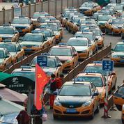 Chine: les taxis de la capitale s'échangent leurs batteries