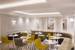 Salle de petit-déjeuner en sous-sol de l'hôtel Pastel
