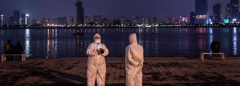Coronavirus: en Chine, les captifs de Wuhan hésitent à ressortir