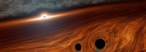 La fusion de deux trous noirs a-t-elle émis de la lumière?