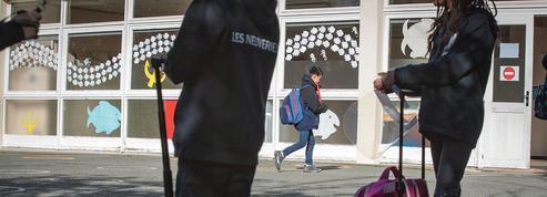 Covid-19: protocole durci à l'école et retour progressif des étudiants à la fac