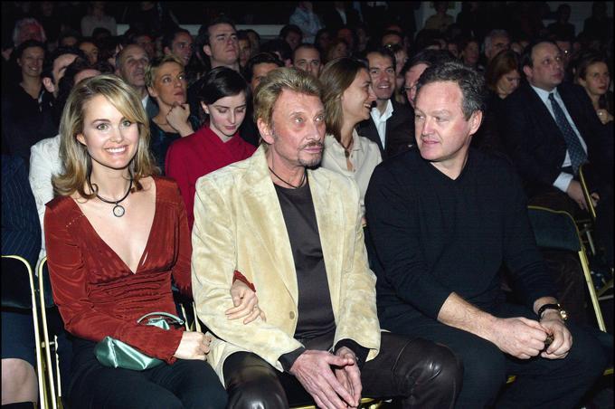 Laeticia Hallyday, Johnny et André Boudou à L'Amnesia Montparnasse en 2004.
