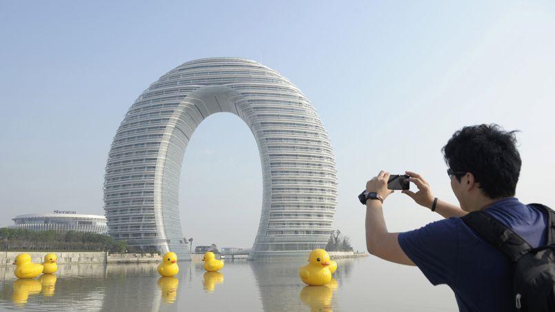 A man takes pictures of the Sheraton Huzhou Hot Spring Resort in Huzhou