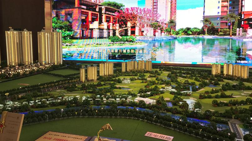 A model shows Evergrande Palm Islands development surrounding a golf course in Huiyang district in Huizhou