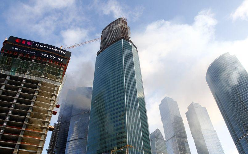 Smoke is seen rising above the towers of the Moscow International Business Center in Moscow