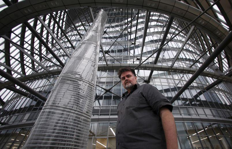 Marshall Strabala, chief architect of the Shanghai Tower, poses for photographs inside the Shanghai Tower, at the financial district of Pudong in Shanghai