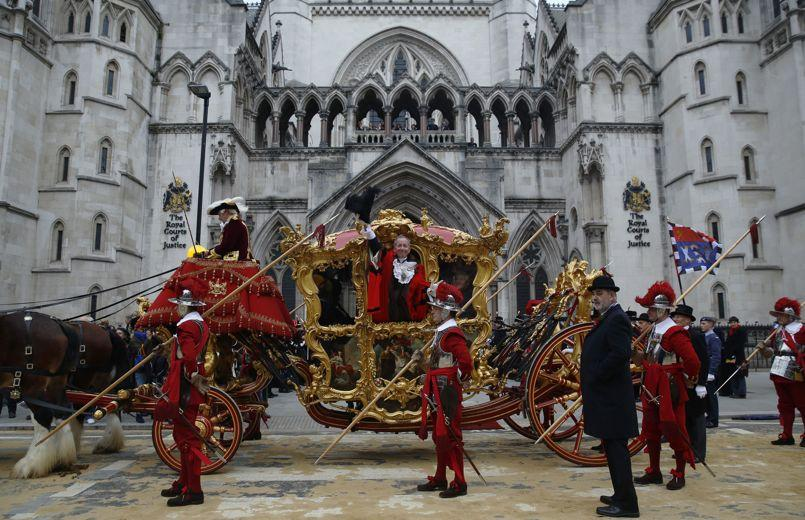 Newly appointed Lord Mayor of London Alan Yarrow waves from a carriage outside the Courts of Justice during the Lord Mayor's show in London