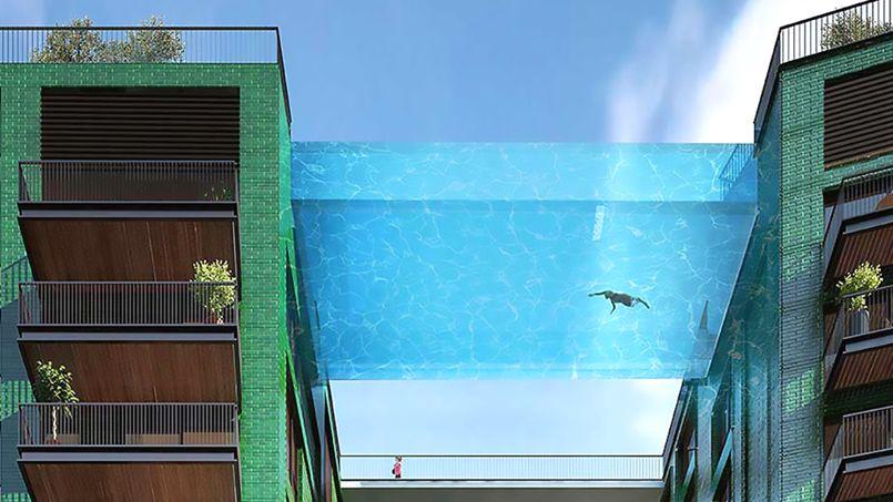 Une incroyable piscine transparente reliant deux immeubles for Hotel piscine londres