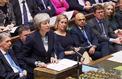 Theresa May annonce au Parlement britannique le report du vote sur l'accord de Brexit
