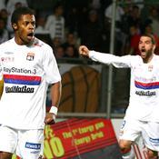 Michel Bastos et Lisandro Lopez avec Lyon en mai 2010.