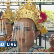 Coronavirus: des danseuses traditionnelles thaïlandaises équipées de visières de protection