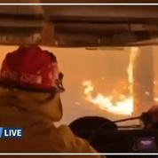 Les images de pompiers australiens conduisant au milieu d'une forêt en feu