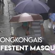 Hongkong : des milliers de hongkongais manifestent masqués