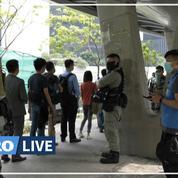 À Hongkong, la police fouille la foule en amont d'un débat parlementaire controversé