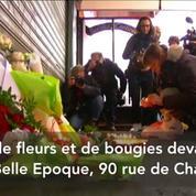 A Paris, des Français rendent hommage aux victimes