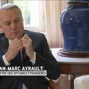 Ayrault: Merkel a moralement et politiquement raison sur les réfugiés