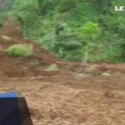 Un glissement de terrain ensevelit des dizaines de villageois en Indonésie