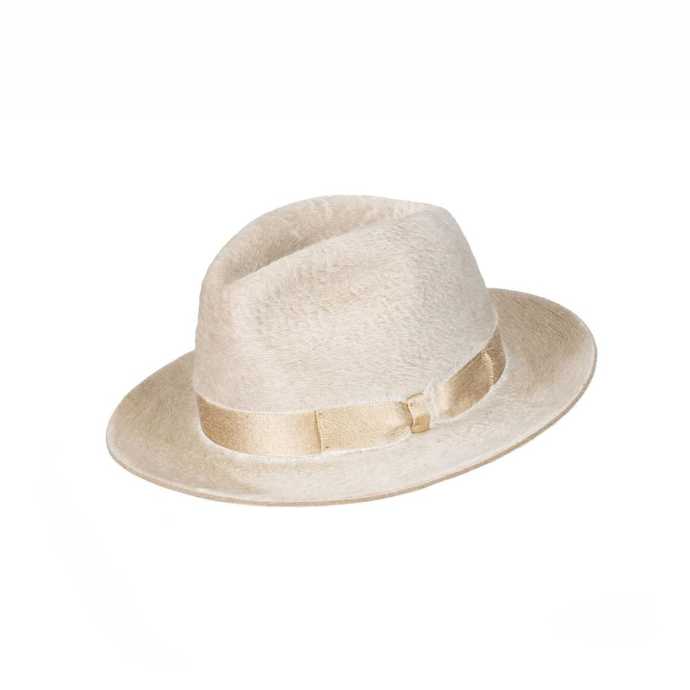 The literal word comes from the French, and it means 'hat'. Aside from meaning 'hat' it is also used when giving someone respect, a short way of saying 'hat off' or 'I'm so impressed, I take my hat off'.