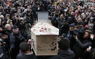 Les funérailles des dessinateurs de<i> Charlie Hebdo</i>