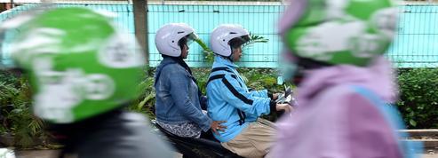 En Indonésie, les motos-taxis pour femmes voilées ont le vent en poupe