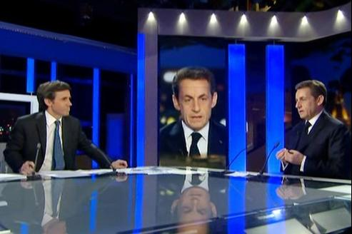 Nicolas Sarkozy mercredi sur le plateau du 20 heures de France 2 avec David Pujadas (G).