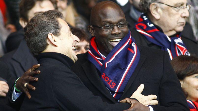 George Weah au Parc des Princes en compagnie de Nicolas Sarkozy en 2013.