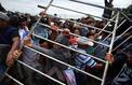 Des milliers de migrants honduriens forcent la frontière entre le Guatemala et le Mexique