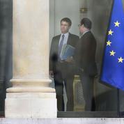 Hollande et Valls tentent de contenir la grogne