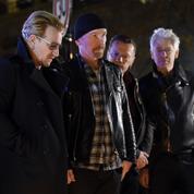 Attentats de Paris : U2 se recueille devant le Bataclan