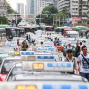 Uber: les taxis pressent Pékin de «faire le ménage»