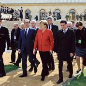 Migrants: François Hollande et Angela Merkel jouent la détente