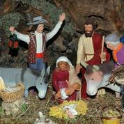 De quoi une crèche de Noël est-elle le signe ?