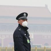 À Pékin, purificateurs d'air et portes closes contre une pollution catastrophique