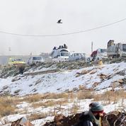 En silence, les rebelles quittent Alep entre des soldats russes