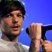 Un chanteur des One Direction arrêté par la police après l'agression d'un photographe