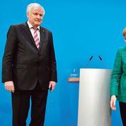 Angela Merkel paie le prix fort pour obtenir sa grande coalition