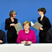 Coalition en Allemagne : Angela Merkel se dit prête «à travailler»