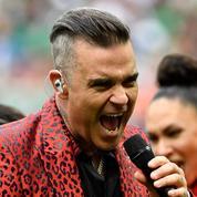 L'explication fumeuse de Robbie Williams sur son doigt d'honneur
