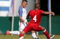 Yasmani Lopez (de dos) contre lesEtats-Unis