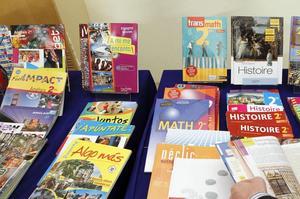 Manuels scolaires imprimés lors la réforme des lycées en 2010 (illustration). - Crédits photo: PATRICK KOVARIK/AFP